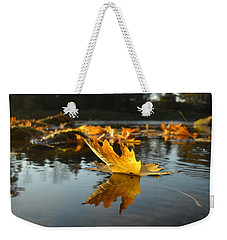 Maple Leaf Floating In River Weekender Tote Bag by Kent Lorentzen