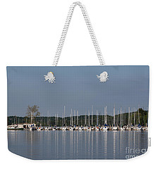 Weekender Tote Bag featuring the photograph Marina by Todd Blanchard
