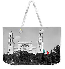 Weekender Tote Bag featuring the photograph Mexico Flag On Merida Cathedral San Ildefonso Town Square Color Splash Black And White by Shawn O'Brien