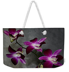 Weekender Tote Bag featuring the photograph Miniature Orchids by Karen Harrison