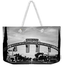 Modesto Arch With Flags Weekender Tote Bag by Jim and Emily Bush