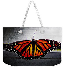Weekender Tote Bag featuring the photograph Monarch by Julia Wilcox