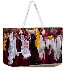 Weekender Tote Bag featuring the photograph Monks Wait For The Dalai Lama by Don Schwartz