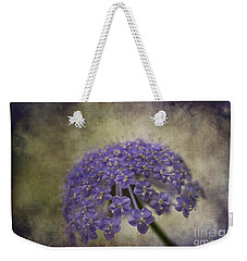 Weekender Tote Bag featuring the photograph Moody Blue by Clare Bambers