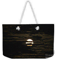 Weekender Tote Bag featuring the photograph Moon Behind The Clouds by William Norton