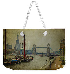 Weekender Tote Bag featuring the photograph Moored Thames Barges. by Clare Bambers