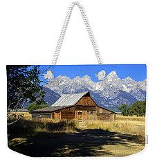Weekender Tote Bag featuring the photograph Mormon Row Barn by Marty Koch