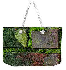 Weekender Tote Bag featuring the digital art Mossy Brick Wall by Carol Ailles