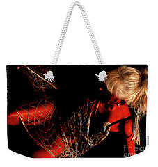 Weekender Tote Bag featuring the photograph Netted A Red by Clayton Bruster