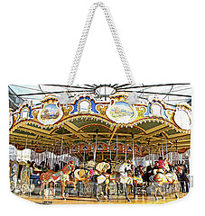 Weekender Tote Bag featuring the photograph New York Carousel by Alice Gipson