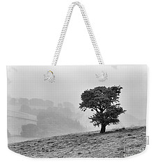 Weekender Tote Bag featuring the photograph Oak Tree In The Mist. by Clare Bambers
