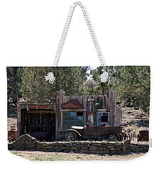 Weekender Tote Bag featuring the photograph Old Filling Station by Athena Mckinzie