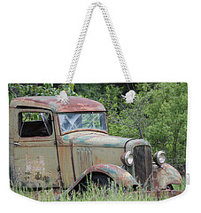 Weekender Tote Bag featuring the photograph Abandoned Truck In Field by Athena Mckinzie