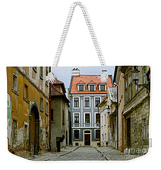 Weekender Tote Bag featuring the photograph Old Street In Bratislava by Les Palenik