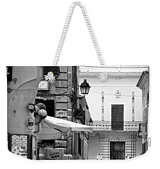 Weekender Tote Bag featuring the photograph Old Town by Pedro Cardona
