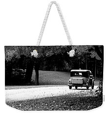 Weekender Tote Bag featuring the photograph On The Road Again by Kay Novy