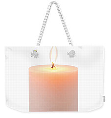 Weekender Tote Bag featuring the photograph Orange Candle by Atiketta Sangasaeng