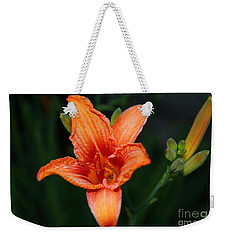 Weekender Tote Bag featuring the photograph Orange Lily by Davandra Cribbie