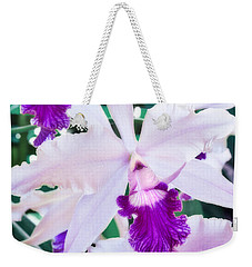 Weekender Tote Bag featuring the photograph Orchids White And Purple by Steven Sparks