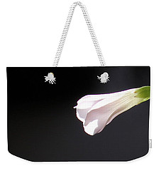Weekender Tote Bag featuring the photograph Oxalis Bud by Kume Bryant