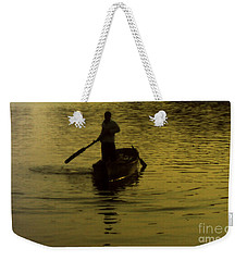 Weekender Tote Bag featuring the photograph Paddle Boy by Lydia Holly
