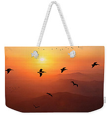 Weekender Tote Bag featuring the photograph Pelican Migration by Chris Lord