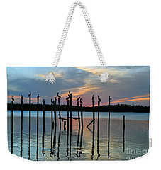 Weekender Tote Bag featuring the photograph Pelican Resting End Of Day by Dan Friend