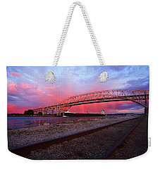 Weekender Tote Bag featuring the photograph Pink And Blue by Gordon Dean II