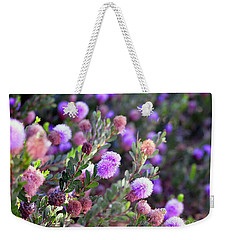 Weekender Tote Bag featuring the photograph Pink Fuzzy Balls by Clayton Bruster