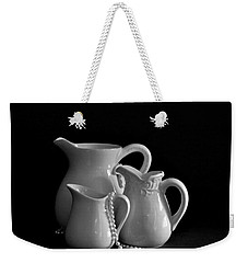 Weekender Tote Bag featuring the photograph Pitchers By The Window In Black And White by Sherry Hallemeier
