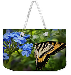 Weekender Tote Bag featuring the photograph Plumbago And Swallowtail by Steven Sparks