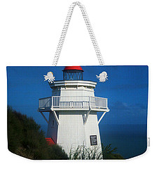 Weekender Tote Bag featuring the photograph Pouto Lighthouse With Rainbow New Zealand by Mark Dodd