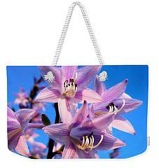 Weekender Tote Bag featuring the photograph Purple Hosta Blooms by Davandra Cribbie