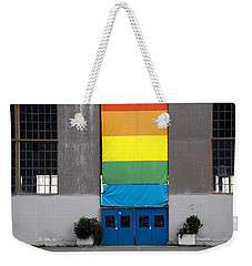 Weekender Tote Bag featuring the photograph Rainbow Banner Building by Kathleen Grace