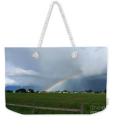 Weekender Tote Bag featuring the photograph Rainbow Before The Storm by Nina Prommer