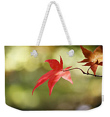 Weekender Tote Bag featuring the photograph Red Leaf. by Clare Bambers