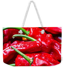 Weekender Tote Bag featuring the photograph Red Peppers by Don Schwartz