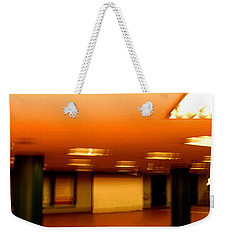 Weekender Tote Bag featuring the photograph Red Subway by Andy Prendy