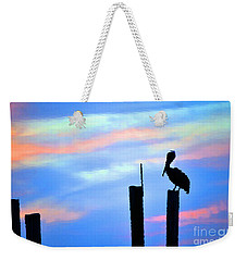 Weekender Tote Bag featuring the photograph Reflections In Water With Pelican by Dan Friend