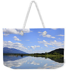 Weekender Tote Bag featuring the photograph Reflections On Swan Lake by Nina Prommer