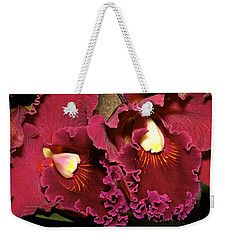 Rich Burgundy Orchids Weekender Tote Bag by Phyllis Denton