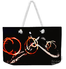 Weekender Tote Bag featuring the photograph Burning Rings Of Fire by Clayton Bruster
