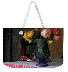 Weekender Tote Bag featuring the photograph Roses In Blue Glass Vase by Lainie Wrightson