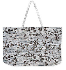 Weekender Tote Bag featuring the photograph Sandpipers In Flight by Dan Friend