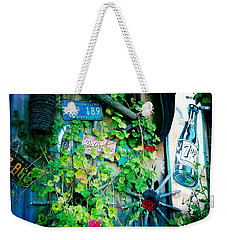 Weekender Tote Bag featuring the photograph Sign Wall by Nina Prommer