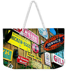 Weekender Tote Bag featuring the photograph Signs Of A Great Place by Nina Prommer