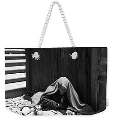 Weekender Tote Bag featuring the photograph Silent Desperation by Lynn Palmer