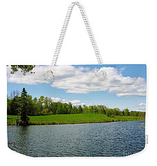 Weekender Tote Bag featuring the photograph Sky And Water Almost Meet by Sherman Perry