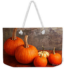 Weekender Tote Bag featuring the photograph Small Decorative Pumpkins by Verena Matthew