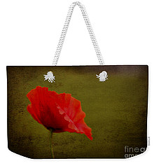 Weekender Tote Bag featuring the photograph Solitary Poppy. by Clare Bambers